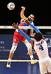 Jackson Rivera with Puerto Rico hits at Dominican Republic blocker Wilfrido Hernandez during the Pan American Cup at the Reno Events Center in Reno, Nev., on Monday, Aug. 17, 2015. <br /> Photo by Cathleen Allison