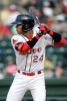 Second baseman Yoan Moncada (24) of the Greenville Drive bats in a game against the Savannah Sand Gnats on Sunday, July 5, 2015, at Fluor Field at the West End in Greenville, South Carolina. The Cuban-born 19-year-old Red Sox signee has been ranked the No. 1 international prospect in baseball by Baseball America. Savannah won, 8-6. (Tom Priddy/Four Seam Images)