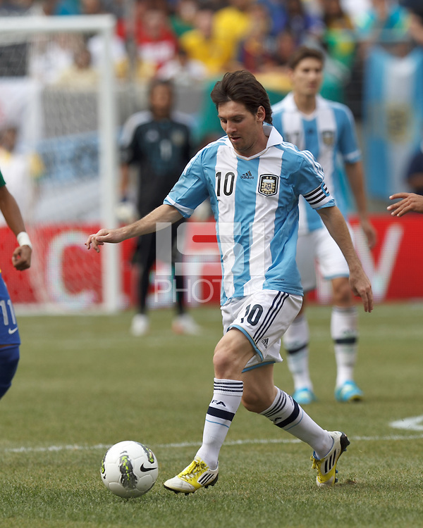 Argentina forward  Lionel Messi (10) dribbles at midfield. In an international friendly (Clash of Titans), Argentina defeated Brazil, 4-3, at MetLife Stadium on June 9, 2012.