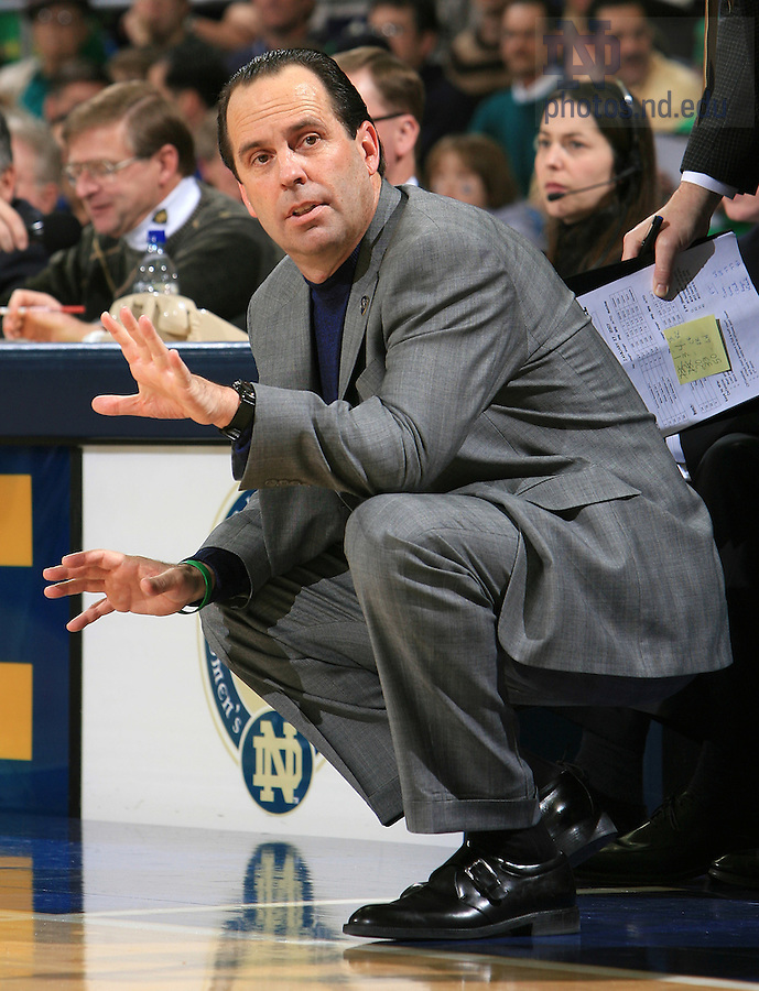 Notre Dame Fighting Irish head coach Mike Brey signals to his team.
