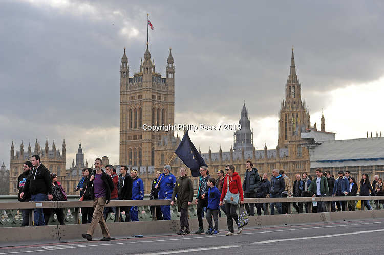 """Protestors cross over Westminster Bridge at the end of  the """"Put it to the People"""" rally which made it's way through central London today. Demonstrators from across the country gathered to call for a second referendum on Brexit and to march through the UK capital finishing with speeches in Parliament Square opposite the Houses of Parliament in Westminster."""