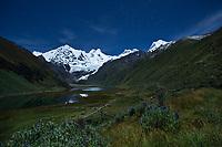 Cordillera Huayhuash mountain range under full moon and starlight, Andes, Peru, South America.