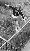 Balancing on the railings, Wester Hailes, Scotland, 1979.  John Walmsley was Photographer in Residence at the Education Centre for three weeks in 1979.  The Education Centre was, at the time, Scotland's largest purpose built community High School open all day every day for all ages from primary to adults.  The town of Wester Hailes, a few miles to the south west of Edinburgh, was built in the early 1970s mostly of blocks of flats and high rises.