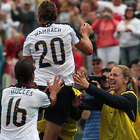 USWNT's Abby Wambach (20) celebrates with teammates after scoring her 100th career goal in the second half. The U.S. Women's National Team defeated Canada 1-0 in a friendly match at Marina Auto Stadium in Rochester, NY on July 19, 2009.