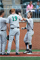 Aaron Bossi (17) of the Marshall Thundering Herd is greeted at home plate by his teammates after hitting a home run during the game against the Charlotte 49ers at Hayes Stadium on April 23, 2016 in Charlotte, North Carolina. The Thundering Herd defeated the 49ers 10-5.  (Brian Westerholt/Four Seam Images)