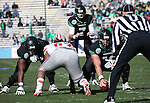 DENTON, TX  JANUARY 1:  Mason Y'Barbo #57 of the North Texas Mean Green snaps the ball to Derek Thompson #7 during the game against the UNLV Rebels  at the Heart of Dallas Bowl at Cotton Bowl Stadium in Dallas on January 1, 2014 in Dallas, TX.  Photo by Rick Yeatts North Texas won 36-14 over UNLV.