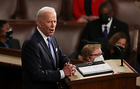 U.S. President Joe Biden delivers his first address to a joint session of the U.S. Congress inside the House Chamber of the U.S. Capitol in Washington, U.S., April 28, 2021. <br /> Credit: Jonathan Ernst / Pool via CNP /MediaPunch<br /> CAP/MPI/RS<br /> ©RS/MPI/Capital Pictures