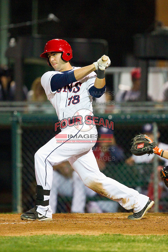 Carlos Lopez (18) of the Hagerstown Suns follows through on his swing against the Delmarva Shorebirds at Municipal Stadium on April 11, 2013 in Hagerstown, Maryland.  The Shorebirds defeated the Suns 7-4 in 10 innings.  (Brian Westerholt/Four Seam Images)