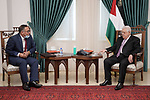 Palestinian President Mahmoud Abbas meets with head of the Palestinian Retirement Authority Majed Al-Helou, in the West Bank city of Ramallah on September 22, 2021. Photo by Thaer Ganaim