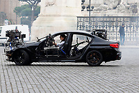 Actor Tom Cruise and actress Hayley Atwell handcuffed together filming a thrilling chase with cars on the set of the film Mission Impossible 7 in Piazza Venezia, just in front of the Victor Emmanuel II Monument (Tomb of the Unknown Soldier). <br /> Rome (Italy), November 29th 2020<br /> Photo Samantha Zucchi Insidefoto