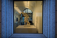 Switzerland. Canton Ticino. Lugano. MASI Lugano at Palazzo Reali . A window on the street offers a view on a art sculpture exhibited in the museum. The Museo d'arte della Svizzera italiana (MASI Lugano) is the product of the unification of the Museo Cantonale d'Arte and Museo d'Arte, both these public institutions have been active in the city of Lugano for many decades. Founded in 2015, after just a few years the MASI Lugano has become one of the most visited art museums in Switzerland. Through its two locations – the LAC cultural centre and the historic Palazzo Reali – it offers a rich programme with temporary exhibitions and changing collection presentations as well as a comprehensive, multilingual educational programme for visitors of all ages. 1.01.2020  © 2020 Didier Ruef