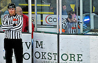 26 November 2010: A third period goal by the Northeastern University Huskies' Tyler McNeely is reviewed by officials during a game against the University of Vermont Catamounts at Gutterson Fieldhouse in Burlington, Vermont. The game-tying goal was allowed, as the Huskies came back from a 2-0 deficit to earn the 2-2 tie against the Catamounts. Mandatory Credit: Ed Wolfstein Photo