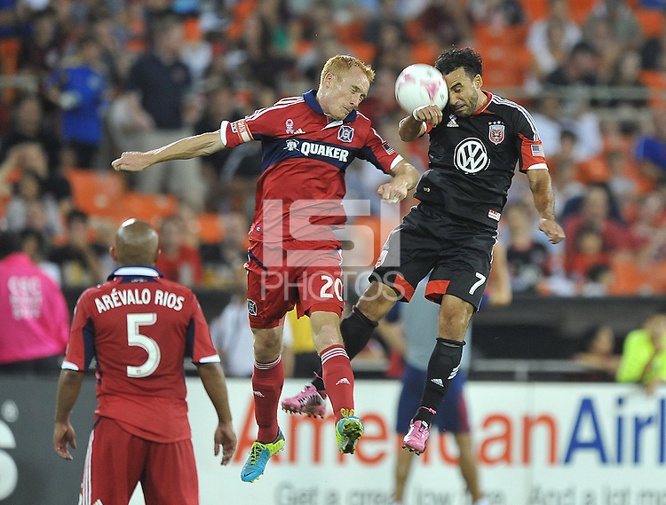 Dwayne De Rosario (7) of D.C. United heads the ball against Jeff Larentowicz (20) of the Chicago Fire.  The Chicago Fire defeated D.C. Untied 3-0, at RFK Stadium, Friday October 4 , 2013.