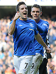 Andy Little celebrates his goal with Kal Naismith