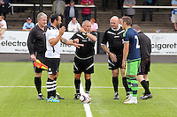 Pictured: The referee tosses the coin, Connor Roberts (R) Saturday 11 July 2015<br /> Re: Merthyr Town FC v Swansea City U21 at the Penydarren Park in Merthyr Tydfil, south Wales, UK.