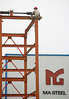Workers build a steel frame at Ma Steel (Maanshan Iron & Steel Co.) in Maanshan, Anhui Province, China..