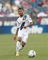LA Galaxy defender Sean Franklin (5) crosses the ball.  In a Major League Soccer (MLS) match, the New England Revolution (blue) defeated LA Galaxy (white), 5-0, at Gillette Stadium on June 2, 2013.