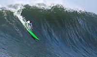 Half Moon Bay, California - January 24, 2014: 2014 Maverick's Invitational Nic Lamb making the drop.