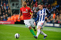 Saturday, 9 March 2013<br /> <br /> Pictured: Luke Moore of Swansea City and Itay Shechter of Swansea City<br /> <br /> Re: Barclays Premier League West Bromich Albion v Swansea City FC  at the Hawthorns, Birmingham, West Midlands
