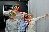 Kids wearing novelty sunglasses and other party favors.