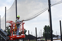GOING, GOING, GONE<br />Eric McBride works Wednesday Oct. 6 2021 on netting at the left-field fence of a ball field at Mt. Hebron Park. The park is under construction at Mt. Hebron Road and Garrette Road in southwest Rogers. Go to nwaonline.com/211007Daily/ to see more photos.<br />(NWA Democrat-Gazette/Flip Putthoff)