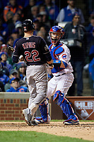 Chicago Cubs catcher David Ross (3) checks the runner as Jason Kipnis (22) bats in the sixth inning during Game 5 of the Major League Baseball World Series against the Cleveland Indians on October 30, 2016 at Wrigley Field in Chicago, Illinois.  (Mike Janes/Four Seam Images)