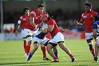 Latiume Fosita of Tonga runs into Johan Tromp of Namibia as Hale T-Pole of Tonga looks on during Match 20 of the Rugby World Cup 2015 between Tonga and Namibia - 29/09/2015 - Sandy Park, Exeter<br /> Mandatory Credit: Rob Munro/Stewart Communications