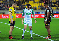 Referee James Doleman waits for Hurricanes Dan Coles (left) and Chiefs Samisoni Taukei'aho to set a scrum during the Super Rugby Aotearoa match between the Hurricanes and Chiefs at Sky Stadium in Wellington, New Zealand on Saturday, 8 August 2020. Photo: Dave Lintott / lintottphoto.co.nz