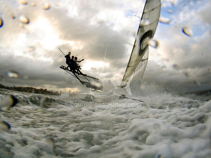 """The 18 Ft Skiff """"Macquarie Real Estate"""" during a training session in Sydney Harbour.."""