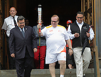Marcel Aubut and Mayor  Denis Coderre exit City Hall with the Olympic torch, June 28,2015.<br /> <br /> Photo : Pierre Roussel - Agence Quebec Presse
