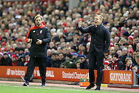Swansea City Manager Garry Monk gestures as he stands in the technical area during the Barclays Premier League Match between Liverpool and Swansea City played at Anfield, Liverpool on 29th November 2015