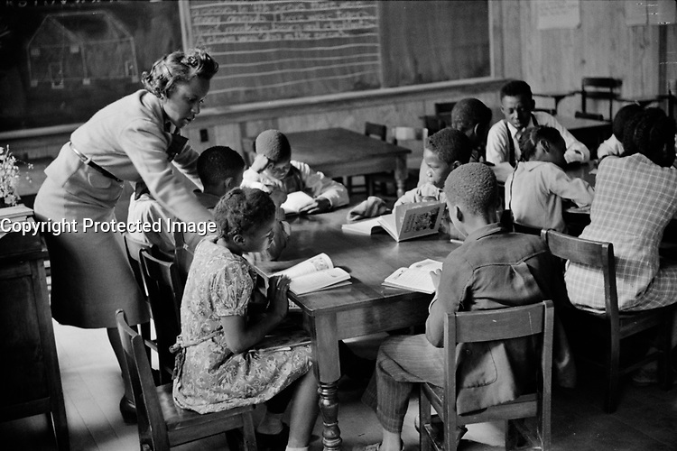 Primary class in new school, Prairie Farms, Montgomery, Alabama 1939.<br /> <br /> Photo by Marion Post Wolcott.
