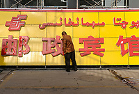 CHINA, autonomous province Xinjiang, city Kashgar, where uyghur people are living , gentrification, new shop with big Han chinese and small uyghur letters / CHINA, Automome Provinz Xinjiang, Stadt Kashgar, hier lebt das Turkvolk der Uiguren, die durch massive Zuwanderung von Han Chinesen zur Minderheit werden, Gentrifizierung, Schild fuer ein neues Geschaeft, grosse chinesische und kleine uigurische Schriftzeichen