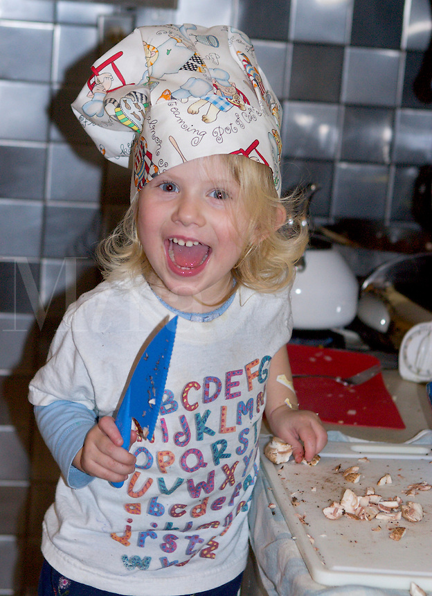 Little girl cutting mushroo