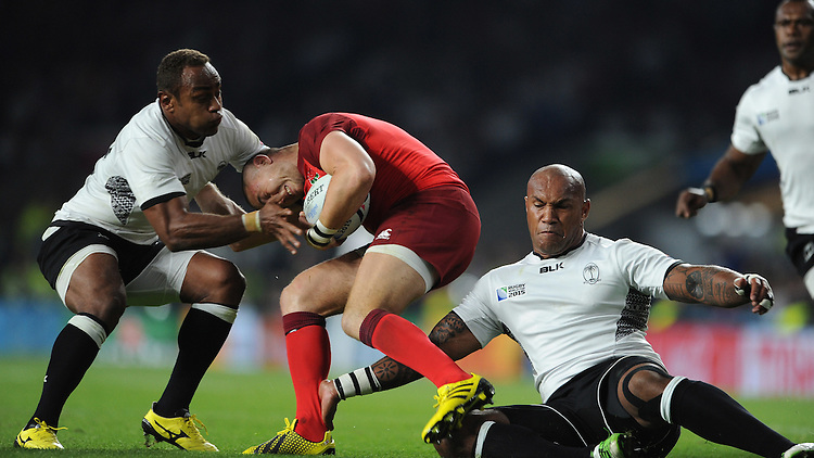 Mike Brown of England is tackled by Nemani Nadolo (R) and Gabiriele Lovobalavu of Fiji during Match 1 of the Rugby World Cup 2015 between England and Fiji - 18/09/2015 - Twickenham Stadium, London <br /> Mandatory Credit: Rob Munro/Stewart Communications