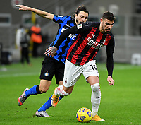 Football Soccer: Tim Cup Quarter Finals InternazionaleMIlan vs Milan, Giuseppe Meazza Stadium (San Siro) Milan, on January 26, 2021.<br /> Milan's Theo Hernandez (r) in action with Inter's Matteo Darmian (l) during the Italian Tim Cup football match between Inter  and Milan at the Giuseppe Meazza stadium in Milan, January 26, 2021.<br /> UPDATE IMAGES PRESS/Isabella Bonotto