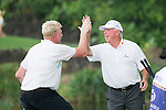 Boris Becker (left) and Mark O'Meara congratulate themselves  during the World Celebrity Pro-Am 2016 Mission Hills China Golf Tournament on 23 October 2016, in Haikou, Hainan province, China. Photo by Marcio Machado / Power Sport Images