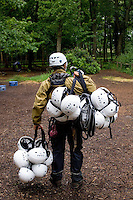 Safety helmets before climbing.  State junior school trip to Outdoor Activities Centre.  .