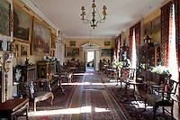 Thomas Merthyr Guest and his wife Theodora's home demonstrates a keen interest in Oriental style furniture; this long hall is lined with pagoda topped cabinets, lacquered and inlaid cupboards and exotic ornaments