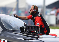 Aug 19, 2016; Brainerd, MN, USA; Crew member with NHRA funny car driver Brian Stewart during qualifying for the Lucas Oil Nationals at Brainerd International Raceway. Mandatory Credit: Mark J. Rebilas-USA TODAY Sports