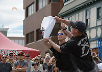 Capt. David Cook, left, and Staff Sgt. Matthew Mobley, right, of the 545th Military Police Detachment at JBER, compete in the water balloon volleyball event at the The Kendall Toyota Hero Games, part of Anchorage's 2016 Downtown Summer Solstice Festival.