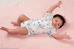 newborn baby girl one month old startle reflex (Moro reflex) horizontal