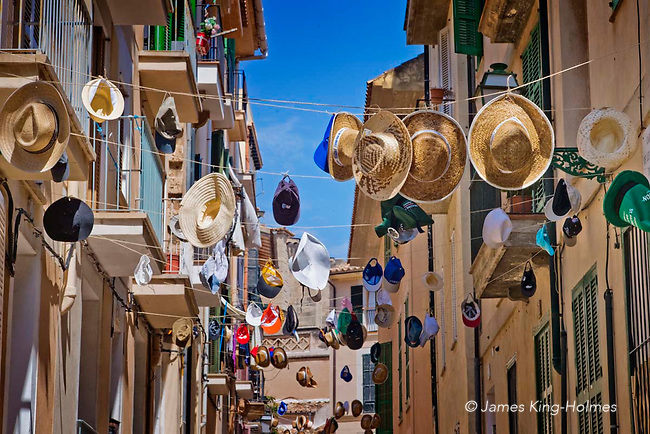 Hats hung above the steet for festival, Carrer de ses Barques de Bou, Palma de Mallorca, Spain