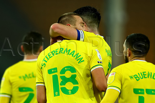 7th November 2020; Carrow Road, Norwich, Norfolk, England, English Football League Championship Football, Norwich versus Swansea City; Marco Stiepermann of Norwich City is embraced by Grant Hanley after his goal for 1-0 in the 84th minute