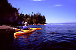 Kayaker in sun, Freshwater Bay near Port Angeles on the Straiti of Juan de Fuca, a good put in to paddle West toward Crescent Beach Olympic Peninsula