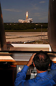 """In Firing Room 4 of the Launch Control Center, NASA Administrator, Dr. Michael Griffin watches the launch of Space Shuttle Discovery on mission STS-121.  Liftoff was on-time at 2:38 p.m. EDT.  During the 12-day mission, the STS-121 crew of seven will test new equipment and procedures to improve shuttle safety, as well as deliver supplies and make repairs to the International Space Station. Landing is scheduled for July 17 at Kennedy's Shuttle Landing Facility. Photo Credit: """"NASA/Bill Ingalls"""""""