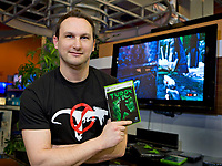 Jason Buchwitz, lead environments artist at Propaganda Studios, shows off their first title 'Turok', a Touchstone title, at the launch event in Vancouver February 5, 2008. (CNW Group/Future Shop Ltd.)