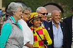 Rafael Bejarano and connections for Unusual Heatwave winner of the Real Good Deal Stakes in the paddock at Del Mar Race Course in Del Mar, California on August 3, 2012.
