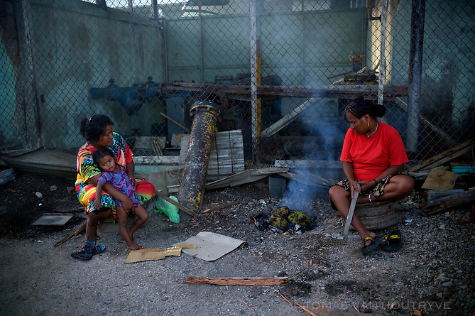Women prepare bread fruit in a pit with coals on Ebeye, Marshall Islands on June 22, 2012. Fresh food and traditional ingredients scarcely seen on Ebeye because all the available land has been filled with slum housing, leaving little room for agriculture.