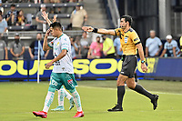KANSAS CITY, KS - AUGUST 10: Referee Juan Gabriel Calderon awards a goal to Club Leon after checking with VAR during a game between Club Leon and Sporting Kansas City at Children's Mercy Park on August 10, 2021 in Kansas City, Kansas.